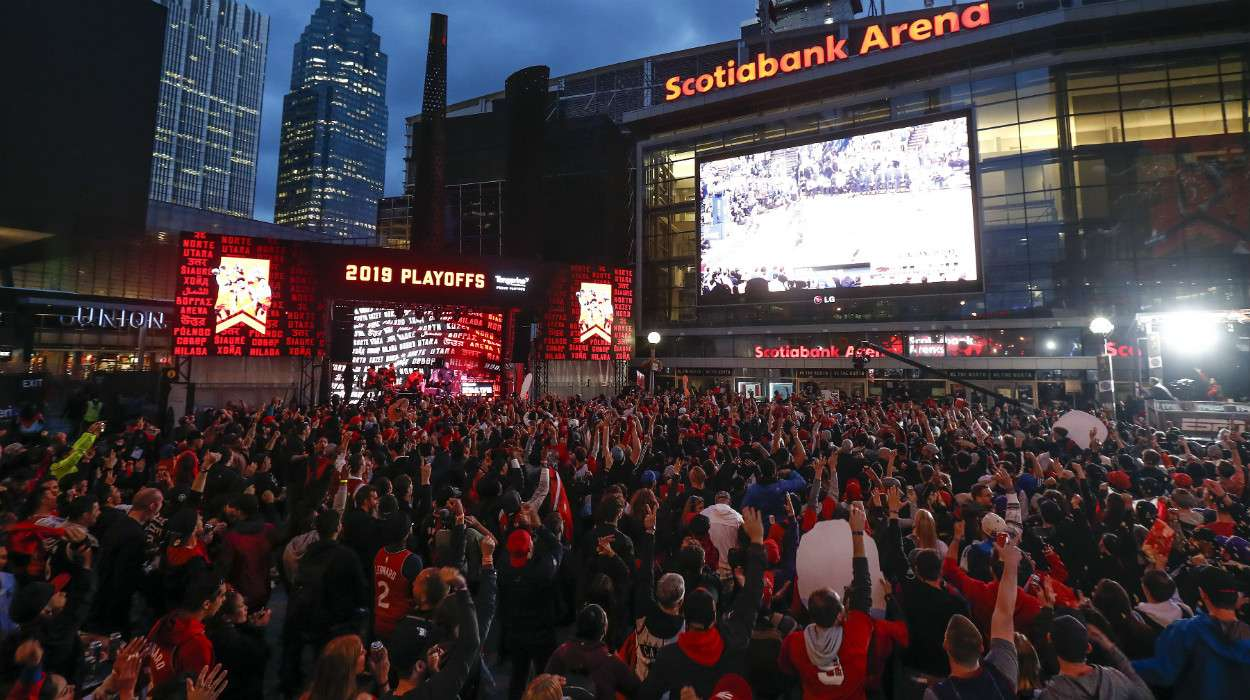 Fans gather outside of Jurrasic Park during Game Six of the NBA Finals on June 13, 2019 at Scotiabank Arena in Toronto