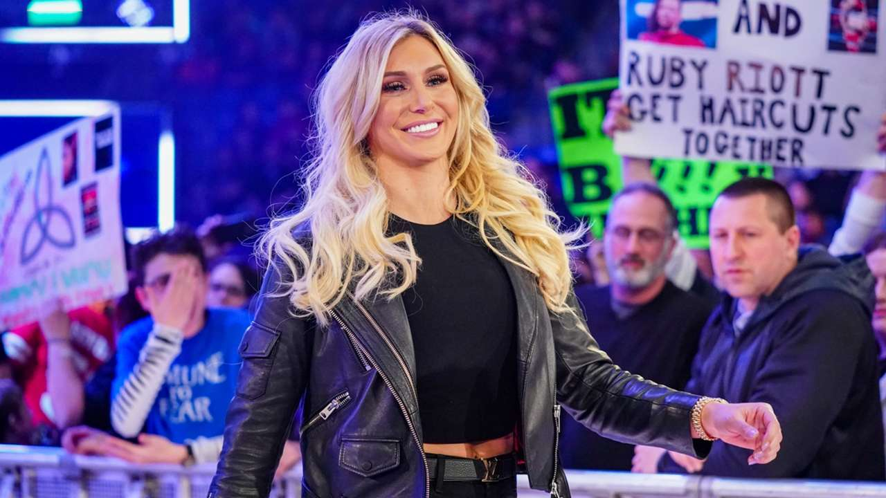 Charlotte Flair makes her way to the ring to discuss her upcoming bout against Becky Lynch at WWE Fastlane.