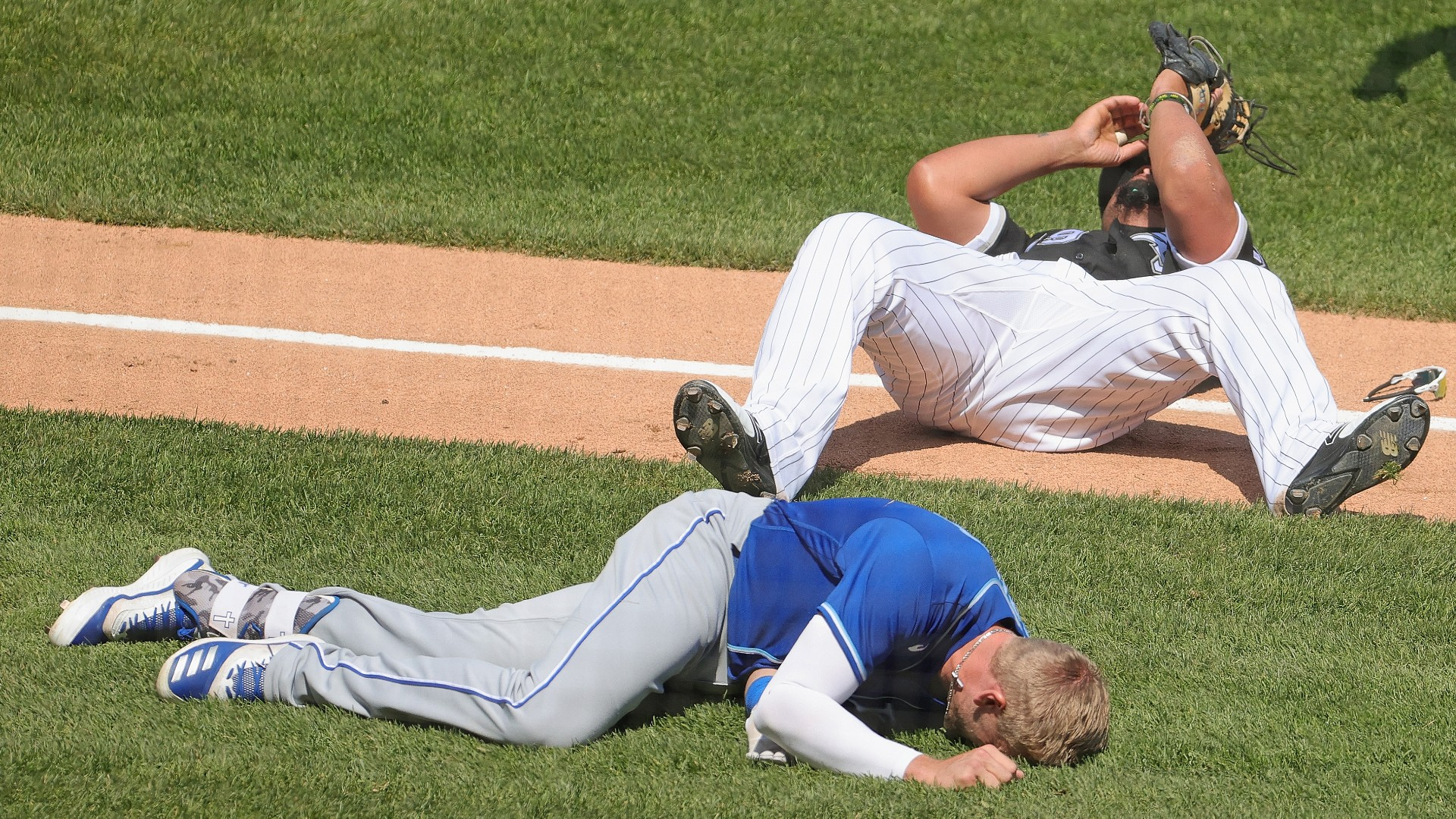 Jose Sreu of the White Sox, Hunter Dozier of the Royals had a terrifying collision