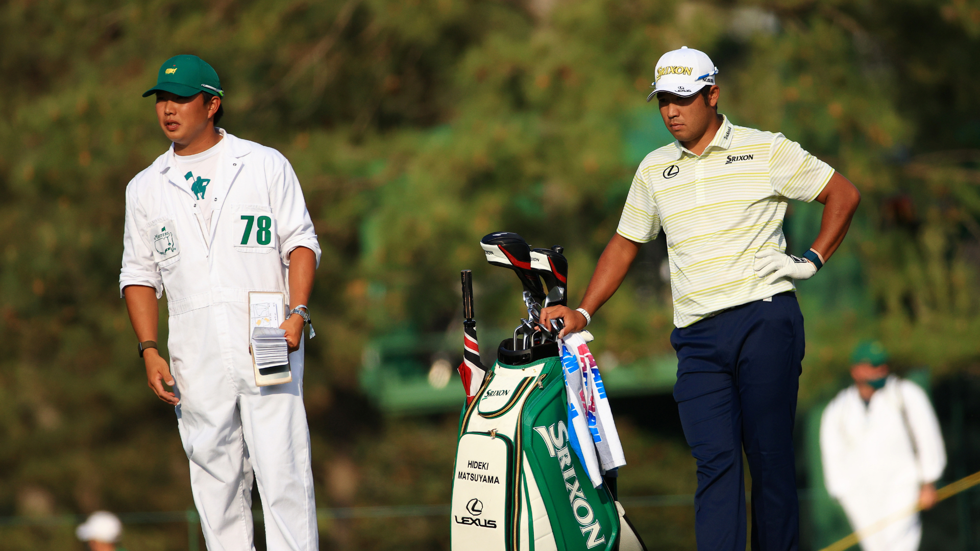 Hideki Matsuyama's caddie bows in respect to Augusta National following Masters win