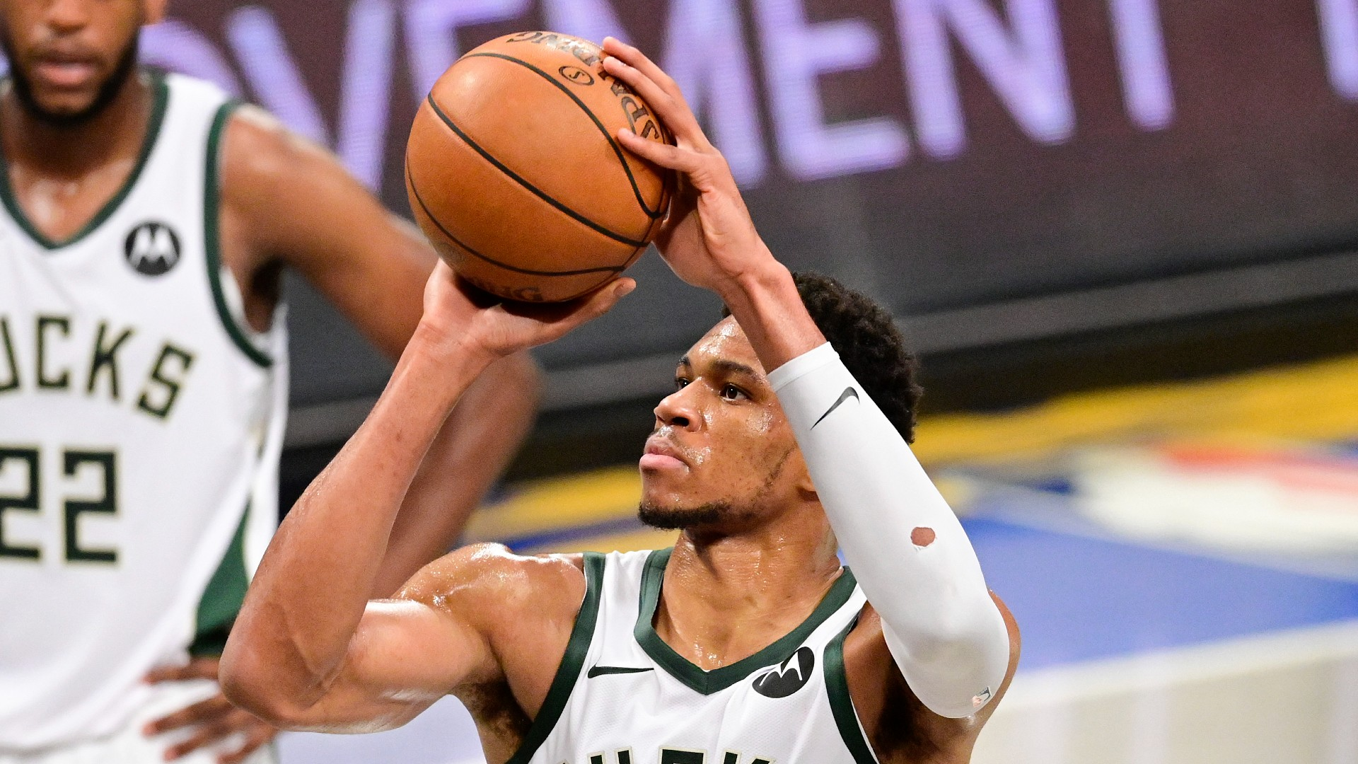 Bucks' Giannis Antetokounmpo calls for a 10-second free kick against Nets