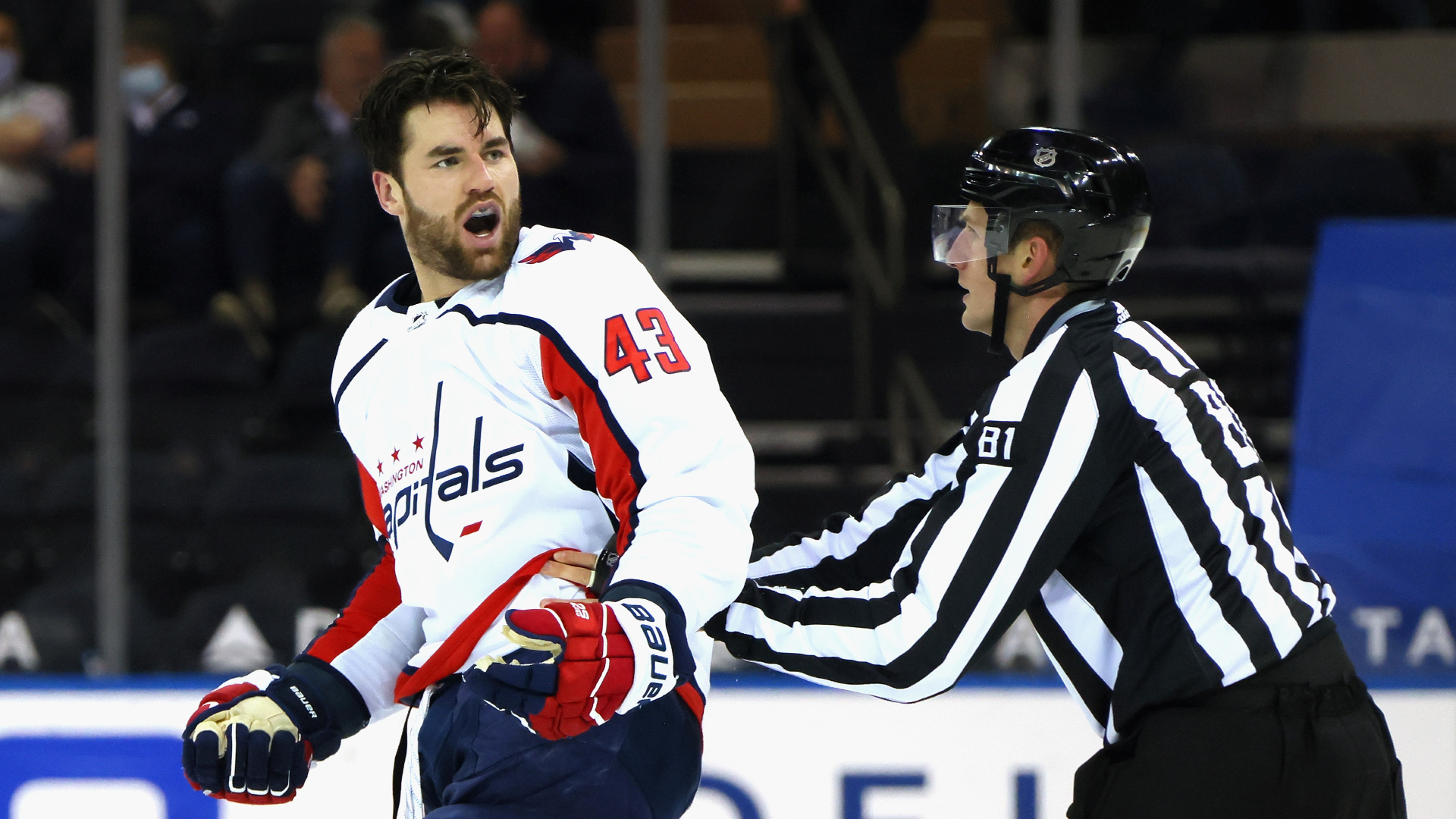 Capitals' Tom Wilson hits Pavel Buchnevich in the head and slams Artemi Panarin on the ice