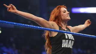 ... but Becky claims the victory after forcing Carmella to tap to the Dis-arm-her!