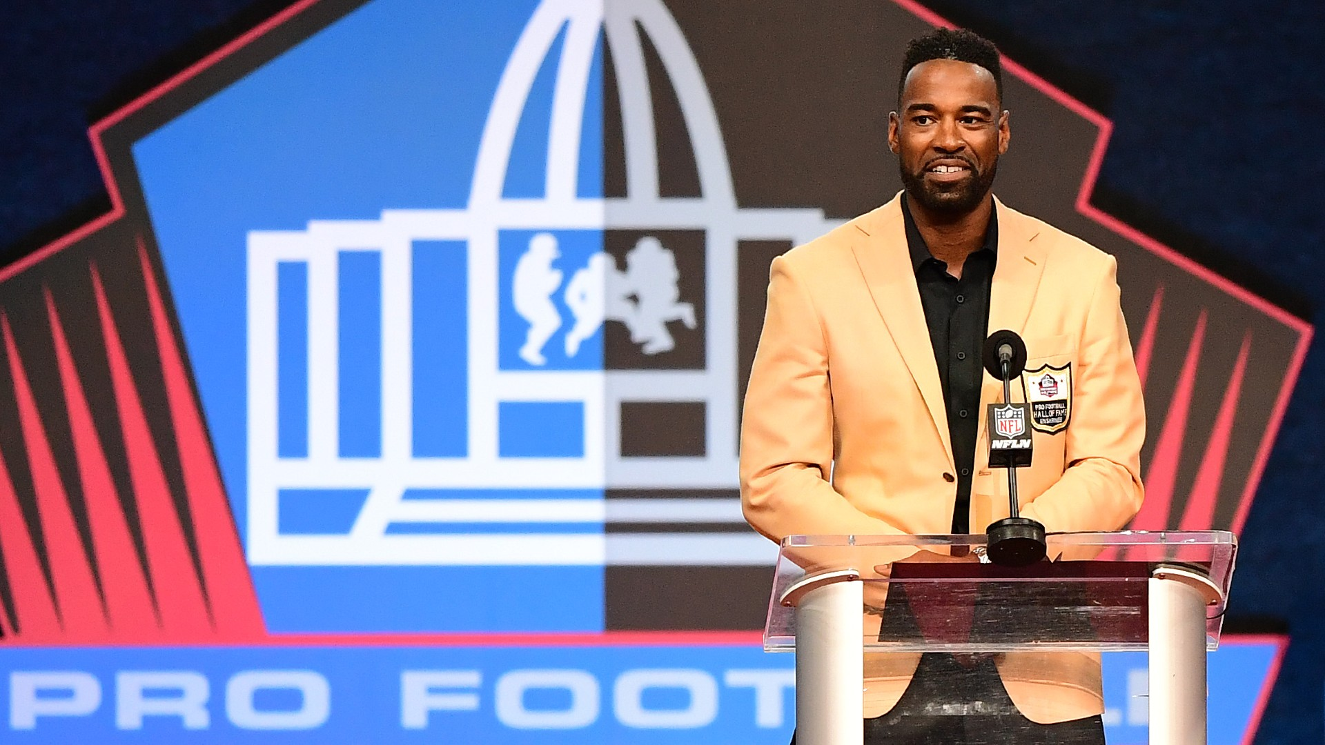 Calvin Johnson says in a Hall of Fame speech that he played most of his career with a back injury: 'The pain never went away'