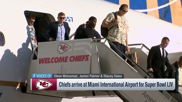 Kansas City Chiefs players walk off the airplane after arriving in Miami